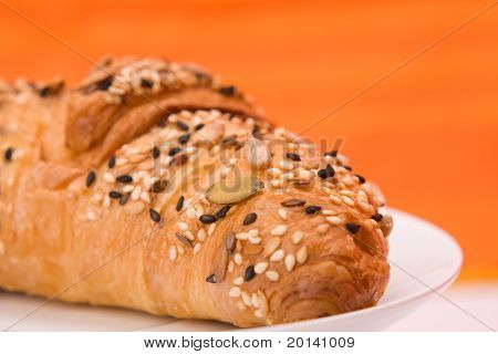 fresh croissant  on orange background