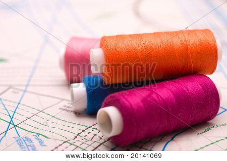 Spool of thread. Sew accessories on blurred background