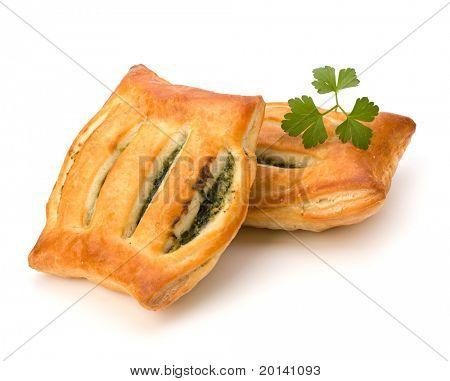 Puff pastry isolated on white background. Healthy pasty with spinach.