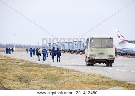 Military Airfield Krasnodar. Operating Aircraft In The Parking Lot. On The Airfield Pilots And Other