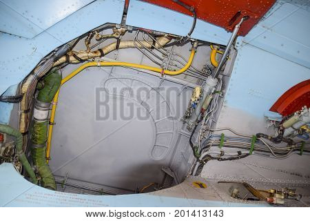 An Open Compartment For Equipment In The Fighter. Su-35 Fighter. Aircraft On The Airfield To Show Th