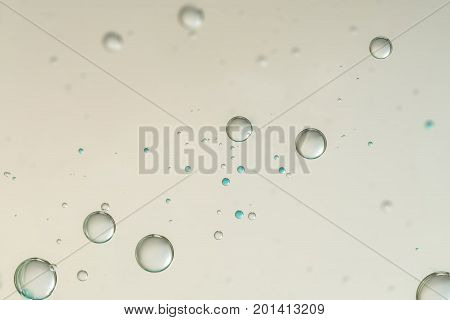Flowing gas bubbles isolated over a blurred background.