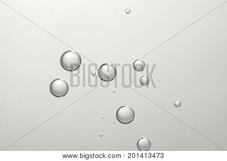Flowing bubbles isolated over a gray background