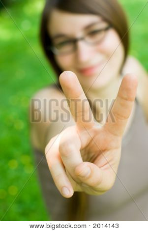 Girl Making Victory Gesture