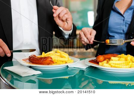 Couple with snack for lunch - sausage and fries