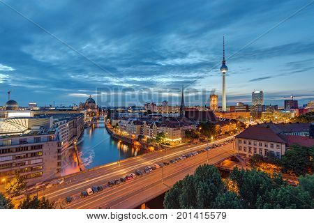 Downtown Berlin with the famous Television Tower and the Spree river at night