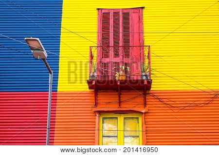 Colorful house in La Boca, Buenos Aires, with balcony and street light