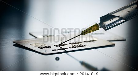 Financial crisis concept: Injecting funds to credit card
