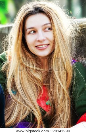 One young cute woman with long blond hair
