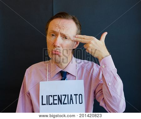 Italian man fired  /a man who was fired( in italian language ) simulates the intention to shoot himself
