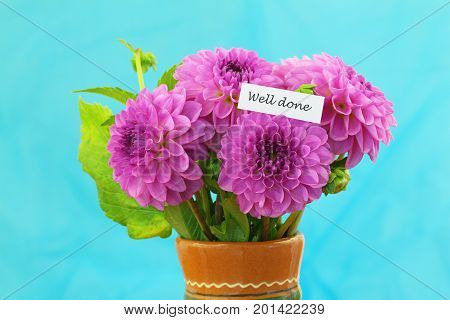 Well done card with pink dahlia flowers on blue background