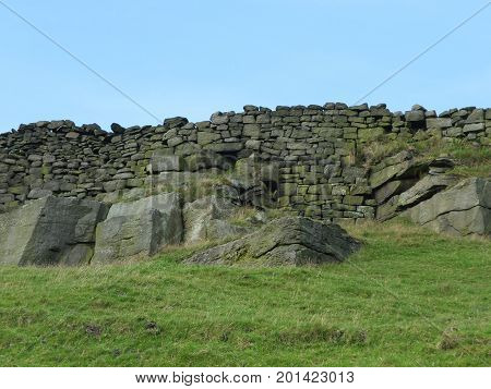 rocky outcrops and stone walls in yorkshire moors