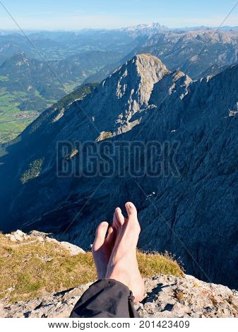 Peak Relaxation. Naked Feets Without Boots On The Background Of The Alps Peaks