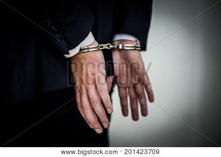 Businessman Arrested With Handcuffs On Back For Corruption And Stealing Millions Of Dollar Euro Mone