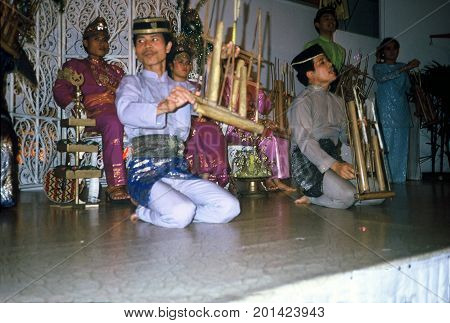 SINGAPORE / CIRCA 1990: Malay musicians perform in a show at the Raffles Hotel.