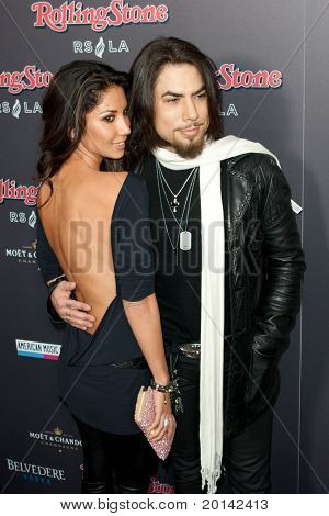 HOLLYWOOD, CA. - NOV 21: Dave Navarro (R) & guest arrive at the 2010 American Music Awards Rolling Stone Magazine VIP After Party at Rolling Stone Restaurant & Lounge on November 21, 2010 in Hollywood