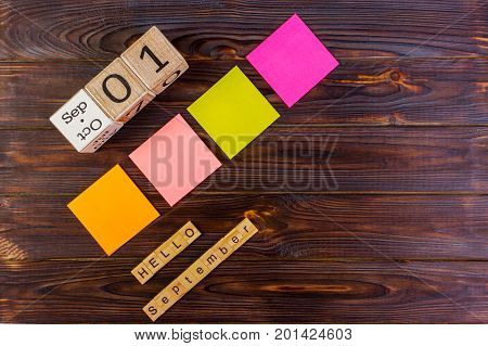 1st September. Image of september 1 calendar on wooden background. Back to school concept. Hello September word. Multicolored paper stickers with copy space