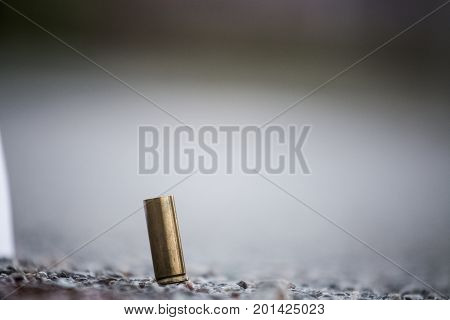 Bullet Shell On The Ground From The Pistol. Crime Scene Investigation Evidence Of A Murder. Close Up