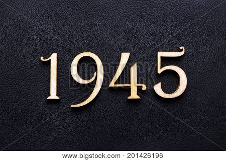 1945. One thousand nine hundred and forty-fifth year. The date of the end of the Second World War. Figures on a black background