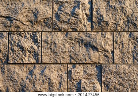 Artificial stone textured finishing on the foundation of the house