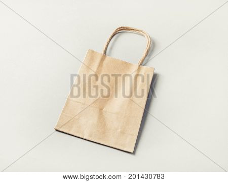 Paper shopping bag on paper background. Craft paper package.