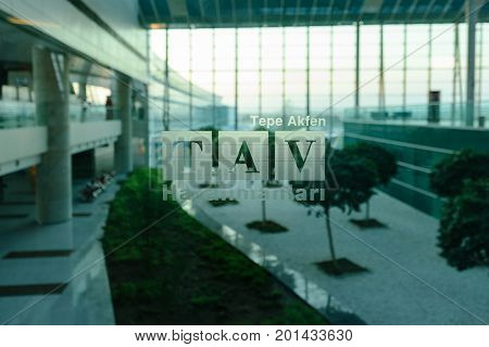 ANKARA, TURKEY - AUGUST 19, 2017: TAV Airports Holding logo on the glass in Esenboga International airport. It is a leading  airport operator in Turkey.