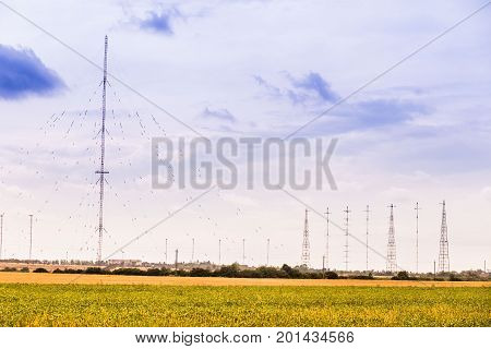 military radio waves against the background of the cloudy sky