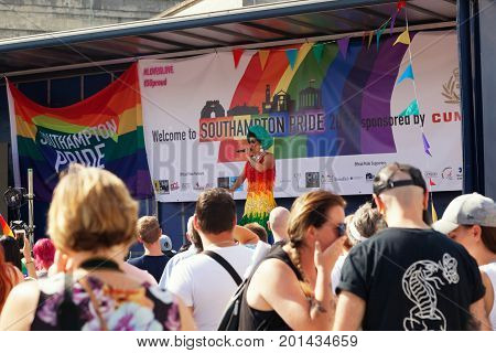 SOUTHAMPTON UK - August 26 2017: Southampton Pride 2017 City's second annual Pride event in Southampton UK. Transvestite performer on stage entertaining the crowd.