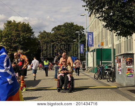 SOUTHAMPTON UK - August 26 2017: Southampton Pride 2017 City's second annual Pride event in Southampton UK. Man pushing man in wheelchair.