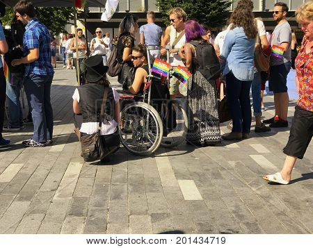 SOUTHAMPTON UK - August 26 2017: Southampton Pride 2017 City's second annual Pride event in Southampton UK. Man in Wheelchair and woman wearing hat.