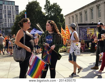 SOUTHAMPTON UK - August 26 2017: Southampton Pride 2017 City's second annual Pride event in Southampton UK. Mother and daughter holding rainbow flags.
