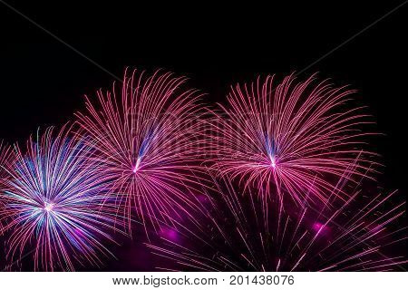 Bright multicolored glowing spheres and flickering stars, fantastic comets, fireworks. Elegant background for all festive occasions