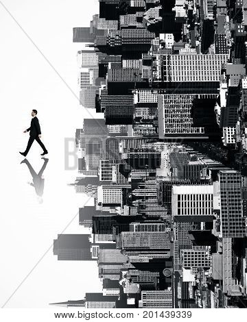 Walking businessman with shadow on abstract sideways city background. Success concept