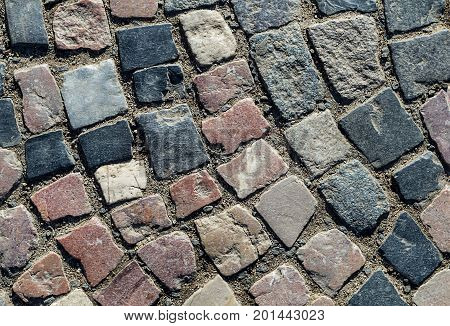 Background surface tile area round with uneven stone gray brick close-up