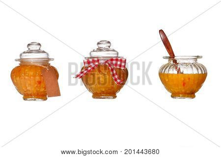 Banks with orange jam on a white background. Isolated. Three variants of packing orange marmalade in a glass jar.
