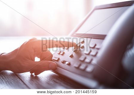 Communication support call center and customer service help desk. Using a telephone keypad.
