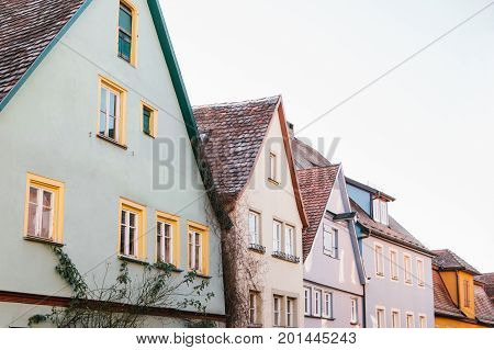 Street with beautiful colorful houses in a row in Rothenburg ob der Tauber in Germany. Europe. Architecture.