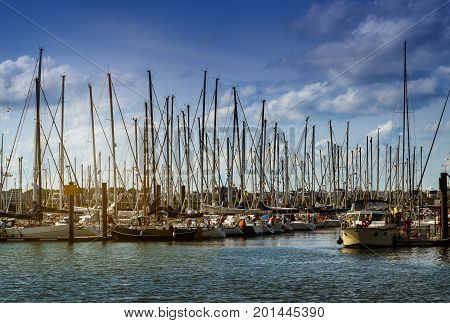 sailing yacht harbor with many sailboats in the evening light against a blue sky with clouds in Cuxhaven Germany