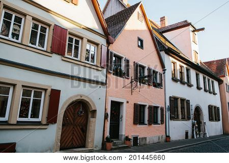 View of traditional German houses in a row in Rothenburg ob der Tauber in Germany. Europe.