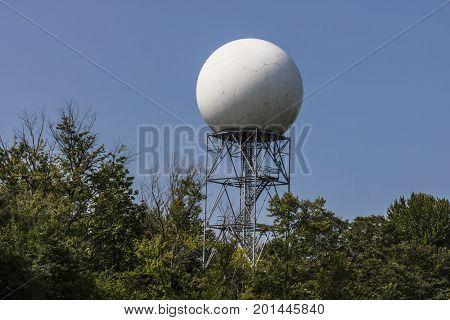 Doppler weather radar among the trees and blue sky II