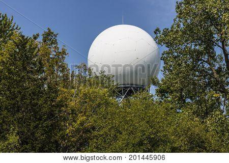 Doppler weather radar hidden by the trees I