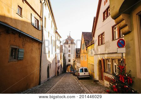 View of the street and the tower during the Christmas holidays in Rothenburg ob der Tauber in Germany.
