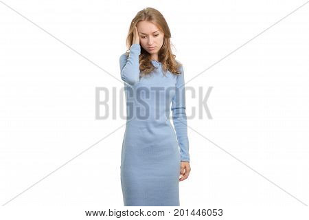 Young woman in dress hurts head on white background isolation