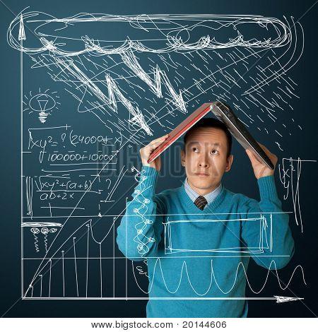 young asian businessman hides under the laptop