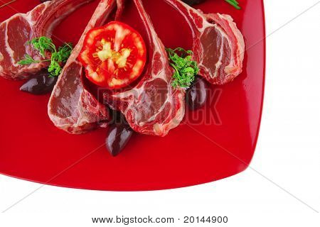 uncooked meat ribs served on red plate