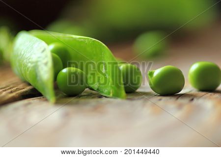 Green peas. Fresh green peas on wooden table