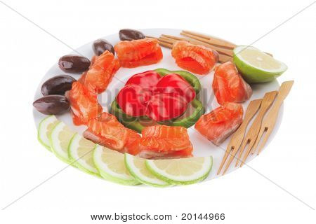 salmon with olives on white round plate