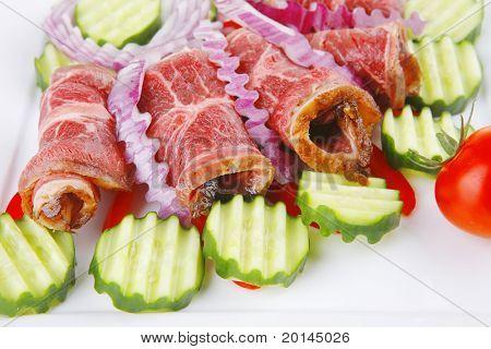 fresh served roasted meat rolls on white platter