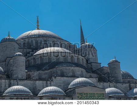 Domes of Sultanahmet Cami (Blue Mosque) in Istanbul with blue sky on the background