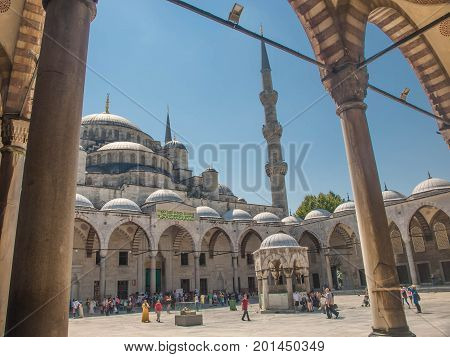 IsTANBUL AUGUST 10 2017 - tourists in the yard of Blue Mosque (Sultanahmet Cami)